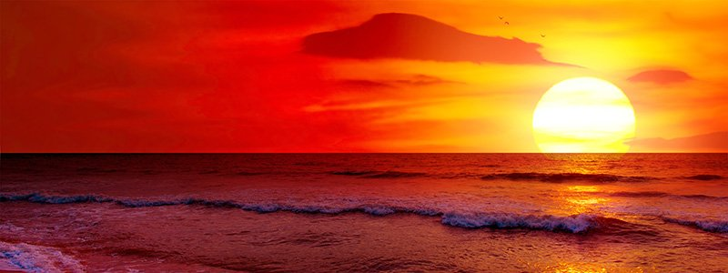 Beautiful warm sunset over ocean with red and yellow colors