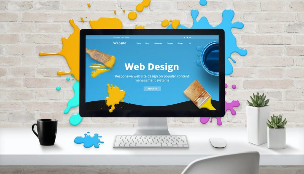 Web safe color design. Modern web site on computer display surrounded by brush color drops