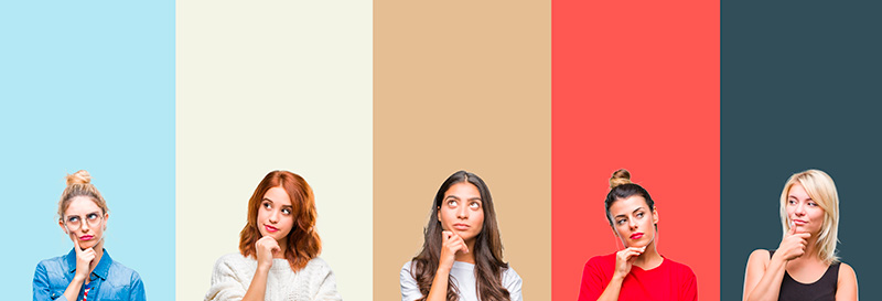 Five women wondering what color is on isolated colorful background
