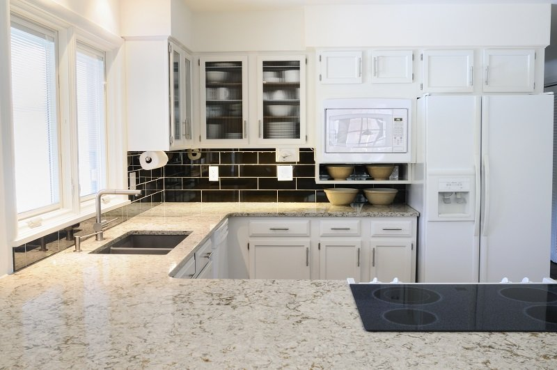 modern kitchen with white cabinets and white appliances