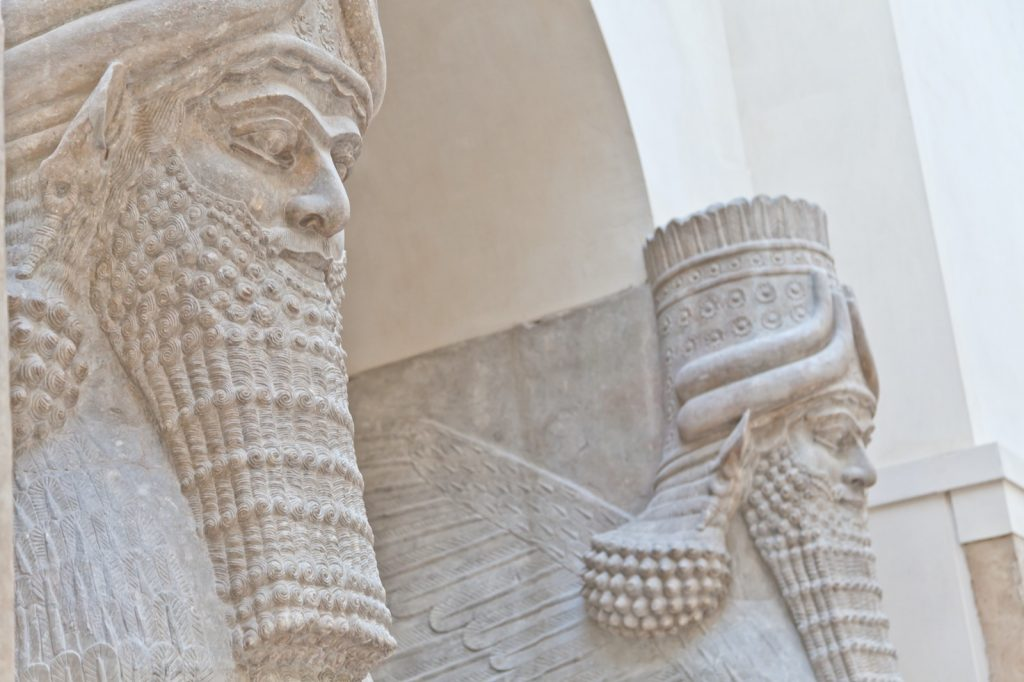 White Mesopotamian temple with decorative wall art