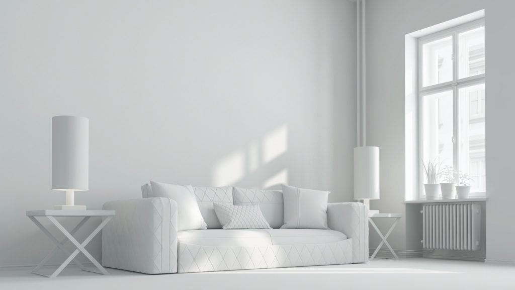 Living room decorated using a monochromatic color scheme with all white furniture and walls