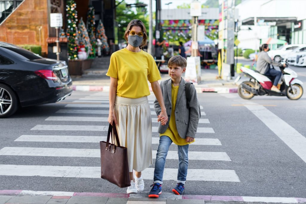Woman and boy wearing yellow and gray fashion colors of 2021