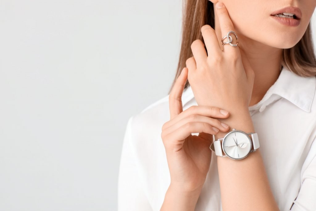 Woman with a stylish white watch on her wrist