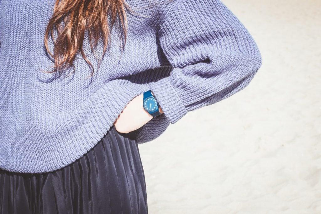 Woman in sweater wearing a blue watch
