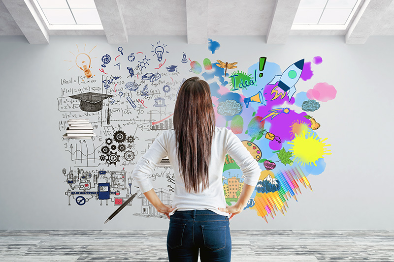 Woman using colors creatively on wall. Left and right brain sides.