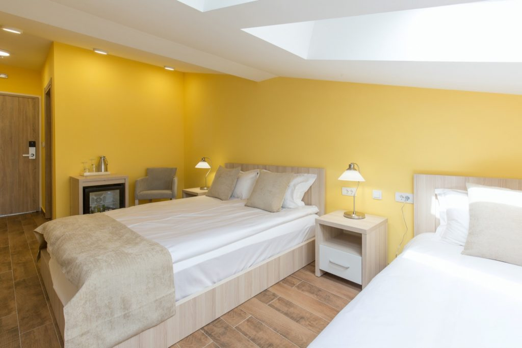 Interior of a yellow bedroom in loft apartment