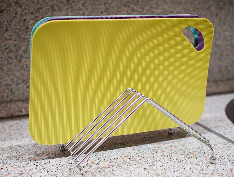 Set of multi-colored cutting boards on a metal stand