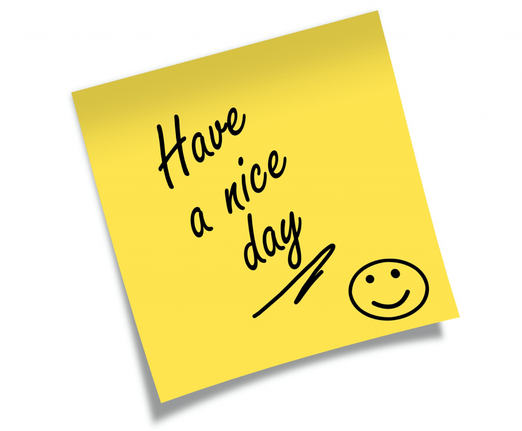 Yellow Post-it with the text Have a nice day and a smiley face
